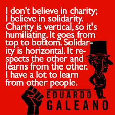 charity vs solidarity